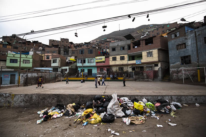 children and trash in a Peruvian slum.