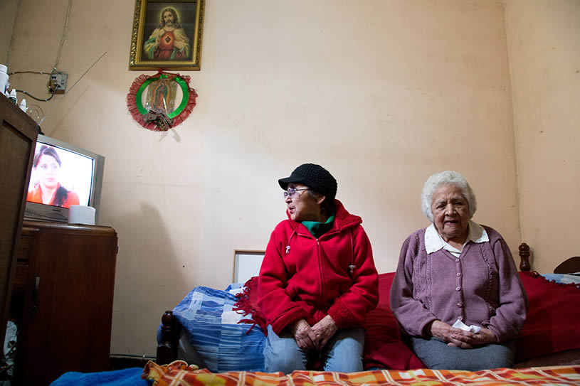 A woman sits with her aunt.
