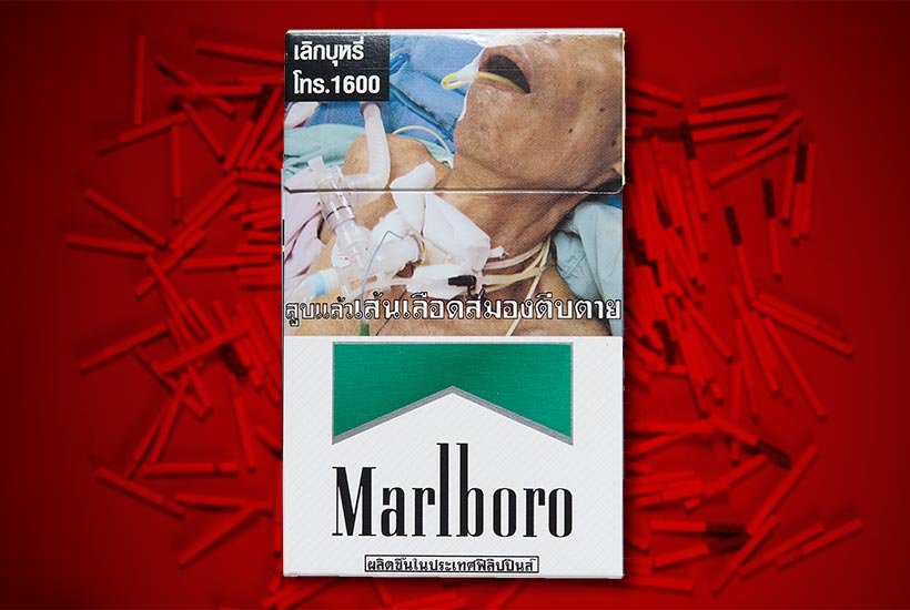 cigarette pack with large graphic a person undergoing throat surgery