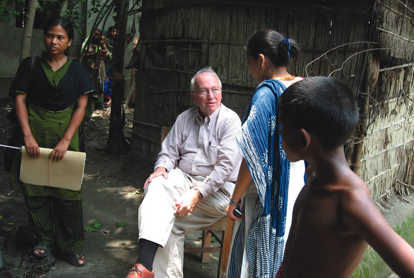 David with a health worker and villagers near the Matlab, Bangladesh in 2007.