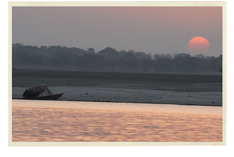 A view from Varanasi at dawn of a boat on its side in the Ganges River.