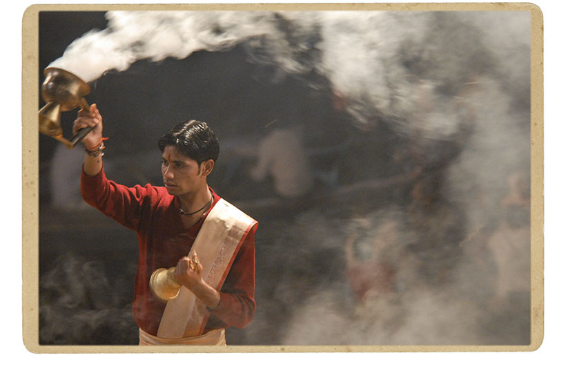 A young priest performs the evening prayer ceremony, or Ganga Aarti, in the holy city of Varanasi.