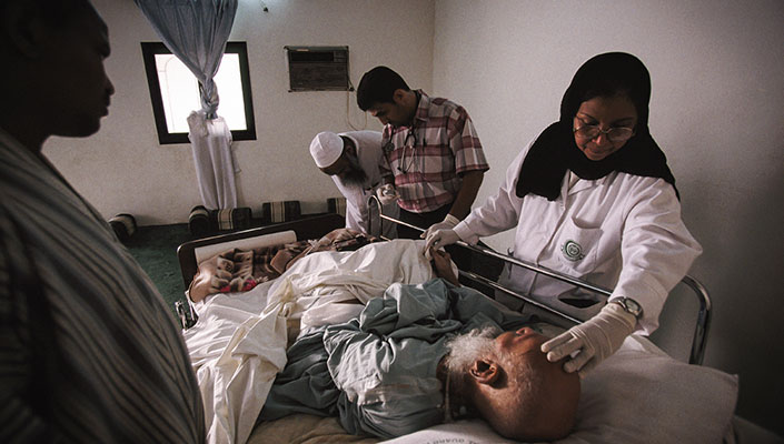 Health care workers tending a patient