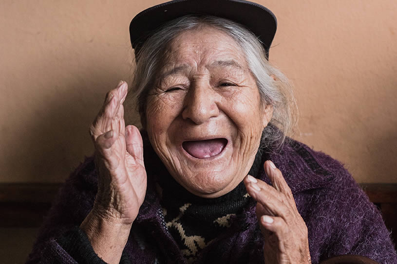 elderly woman in laughing.