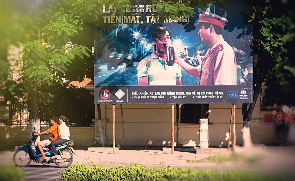 "Education and Enforcement: This billboard in northern Vietnam warns drivers that police will check for ""drink-driving."""