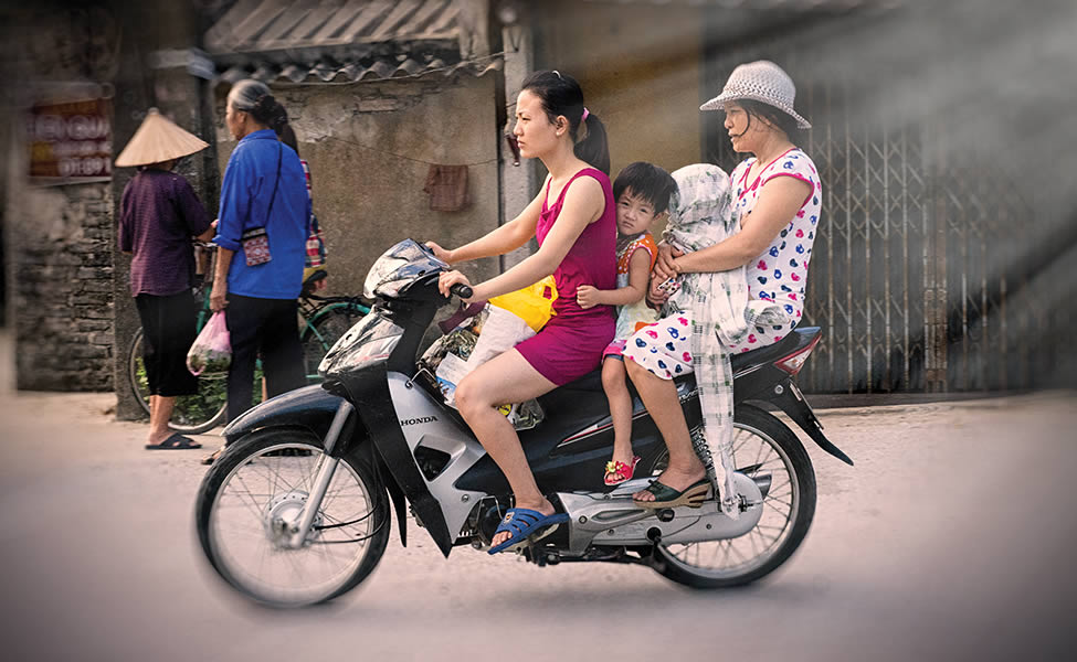 Unprotected: Adults and children alike ride without helments in Ninh Binh Province, south of Hanoi.