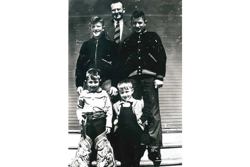 The brothers at a young age posing with their father, Nobel.