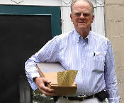 Cunningham holding box of punch cards