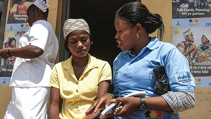 A community mobilizer and a potential client discuss family planning at a clinic in Nigeria.