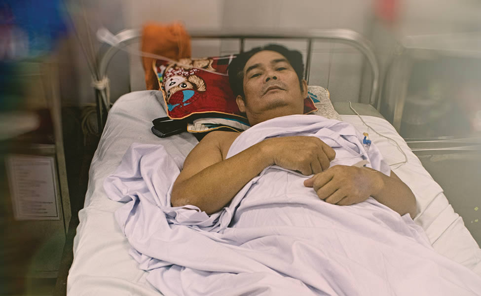 Recovery: Hitting gravel on a curve caused pham Cao to crash his motorbike on a rural section of the Ho Chi Minh Highway.