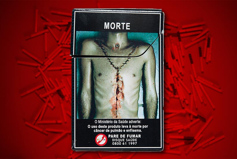 full warning graphic of a post-autopsy body on the back of a cigarette pack