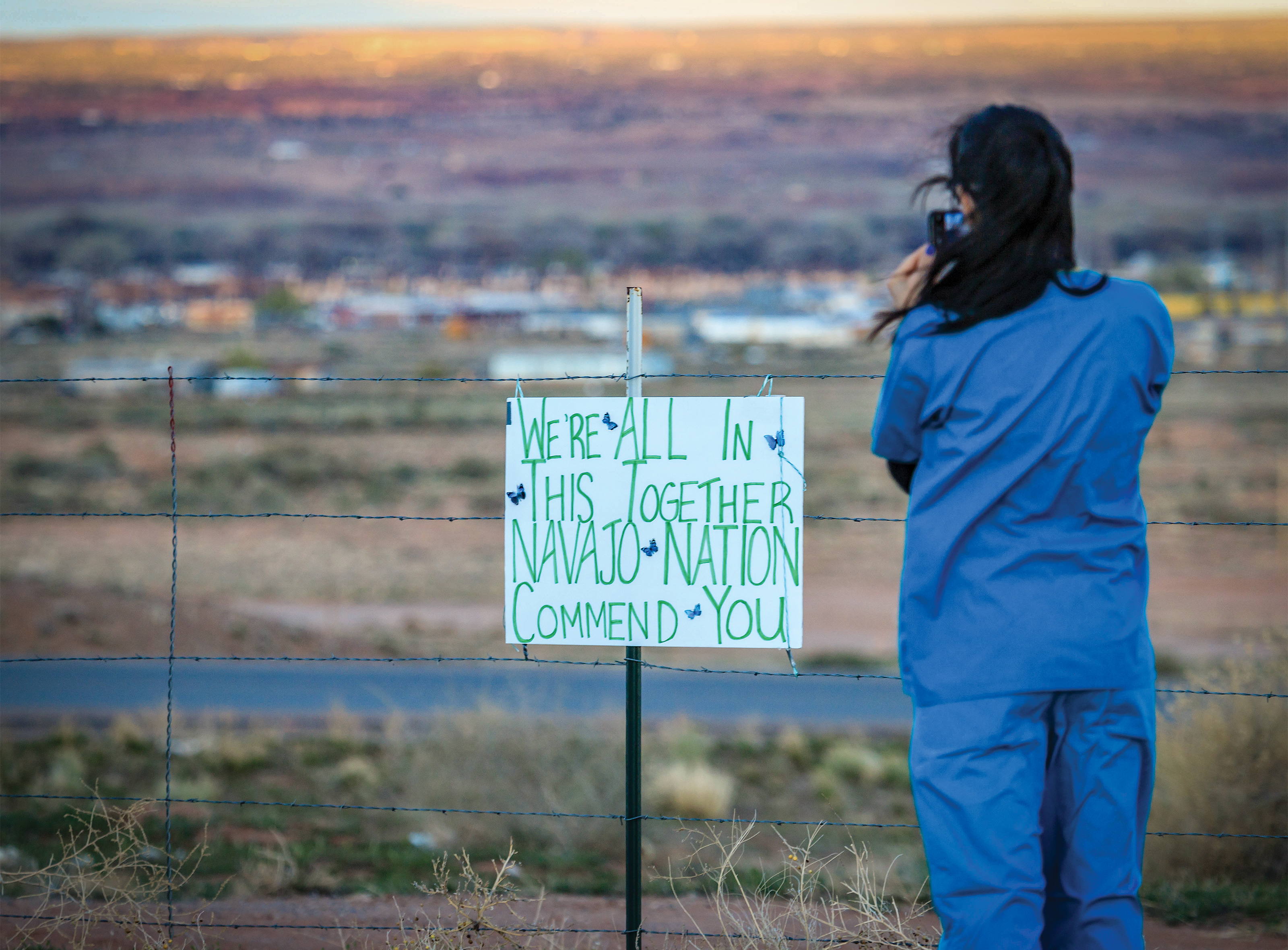 A nurse practitioner snaps a photo on April 8 in Apache County, Arizona—the middle of the Navajo Nation. Beside her, a handmade sign thanks local hospital staff during the pandemic.