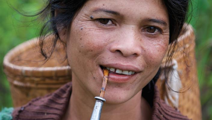 Rural Laotian women smoking