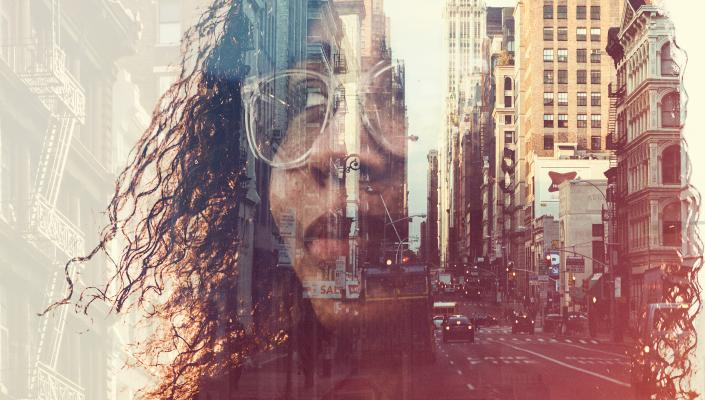 Person of color superimposed over a city streetscape.