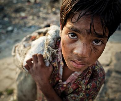 12 year-old-boy scavenging in Bangladesh.