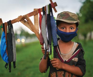 Ramazan, 9, selling masks in Islamabad, Pakistan