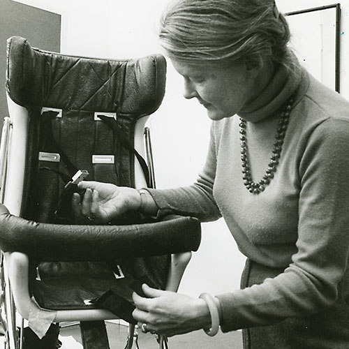 Sue Baker demonstrating an early child safety seat